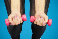 Woman with two dumbbells on legs Stock Image