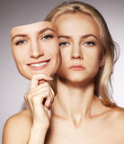 Woman with two faces. Mask. Woman hiding under the happy mask.  Hypocritical,  insincere, two-faced female Stock Photo