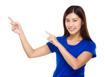 Woman with two finger point up Stock Photography