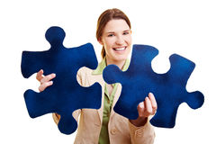 Woman with two fitting jigsaw Royalty Free Stock Photo