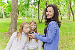 Woman with two girls drinking tea Royalty Free Stock Photo