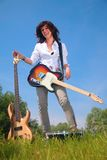 Woman with two guitar on grass Royalty Free Stock Image