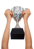 Woman two hand holding a champion silver trophy on white backgro Royalty Free Stock Photos