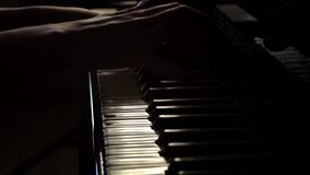 Woman two hands plays classical music on a grand piano close up in slow motion. Woman two hands plays gentle classical music on a beautiful grand piano in a stock video footage