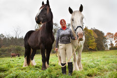 Woman with two horses Stock Photos