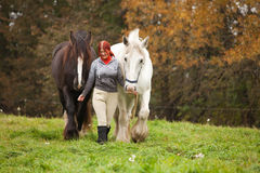 Woman with two horses Royalty Free Stock Images