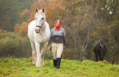 Woman with two horses Stock Photo