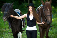 Woman with two horses Royalty Free Stock Image