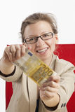 Woman with two hundred Euro banknote. Young woman is happy about hundred euros Stock Photography