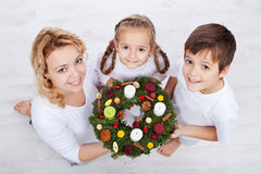 Woman with two kids holding advent wreath Stock Photography