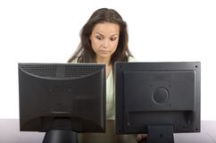 Woman at the two lcd screens Royalty Free Stock Image