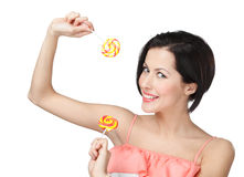 Woman with two lollypops Stock Images