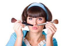 Woman with two make-up brushes Stock Images