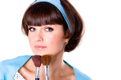 Woman with two make-up brushes Royalty Free Stock Photos