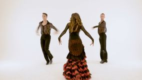 Three professional ballet dancers, retro dance in studio, on white background. A woman and two men, professional ballet dancers, retro dance on a white stock footage