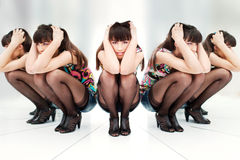 Woman between two mirrors Royalty Free Stock Image
