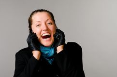 Woman with two mobile phones Royalty Free Stock Images