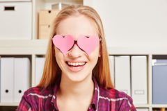 Woman with two pink harts in front of her eyes Royalty Free Stock Photos