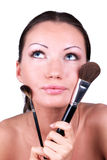 Woman with two professional make-up brushes Stock Image