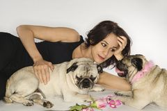 Woman with two Pug dogs. Royalty Free Stock Photos