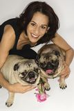 Woman with two Pug dogs. royalty free stock image
