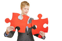 Woman with two red jigsaw puzzle pieces Stock Photo
