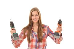 Woman with two self-drilling screws. Young woman holding two drills in the air Royalty Free Stock Photography