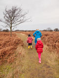 Woman and two small children walking in a dunes in winter Stock Photography
