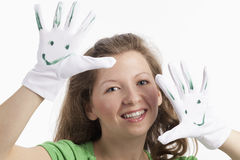 Woman with two smileys Stock Photography