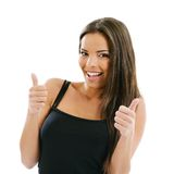 Woman with two thumbs up. Photo of an excited young female doing the two thumbs up gesture over white background Stock Photos
