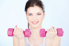 Woman with two weights Royalty Free Stock Photography