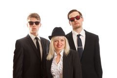 Woman with two young adults stock photo
