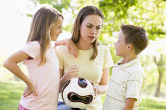 Woman and two young children outdoors