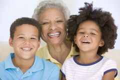 Woman and two young children smiling. Close up of woman and two young children smiling Stock Images