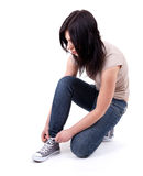 Woman tying gym shoes Royalty Free Stock Photos