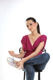 Woman tying her shoe lace Royalty Free Stock Photography