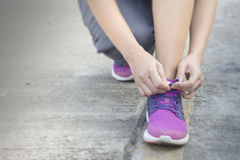 Woman tying her shoes preparing for a jog Royalty Free Stock Photography