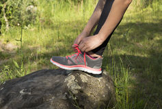 Woman tying her sports shoes Royalty Free Stock Images