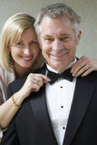 Woman Tying Husband's Bow Tie Stock Photos