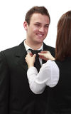Woman Tying Man's Tie Stock Photo