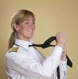 Woman tying necktie Stock Photos