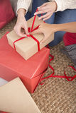 Woman tying red ribbon bow Royalty Free Stock Photos