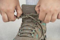 Woman Tying Shoe - Closeup Royalty Free Stock Photo