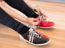 Woman Tying Shoe Lace in Club Royalty Free Stock Images