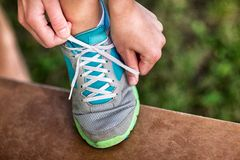 Woman Tying Shoelace Royalty Free Stock Photography