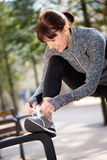 Woman tying shoelace before workout Stock Image