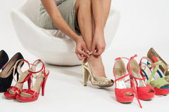 Woman tying shoes Stock Photos