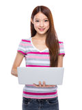 Woman type on notebook computer Stock Image
