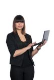 Woman types on a netbook Stock Photos