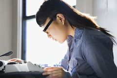 Woman with typewriter. Stock Images